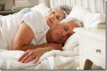 Senior Couple Asleep In Bed Together